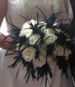 white roses with black feathers wedding bouquet