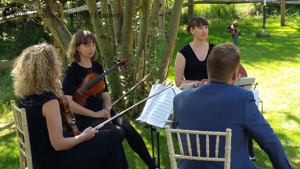 The 4 Piece String Quartet played the wedding march